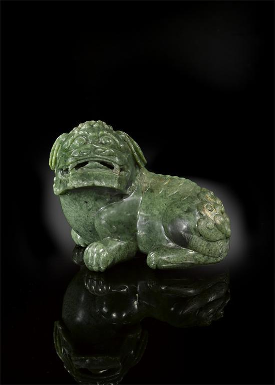 An Extremely Rare Chinese Imperial Gilded Spinach-Green Jade Buddhist Lion Dog