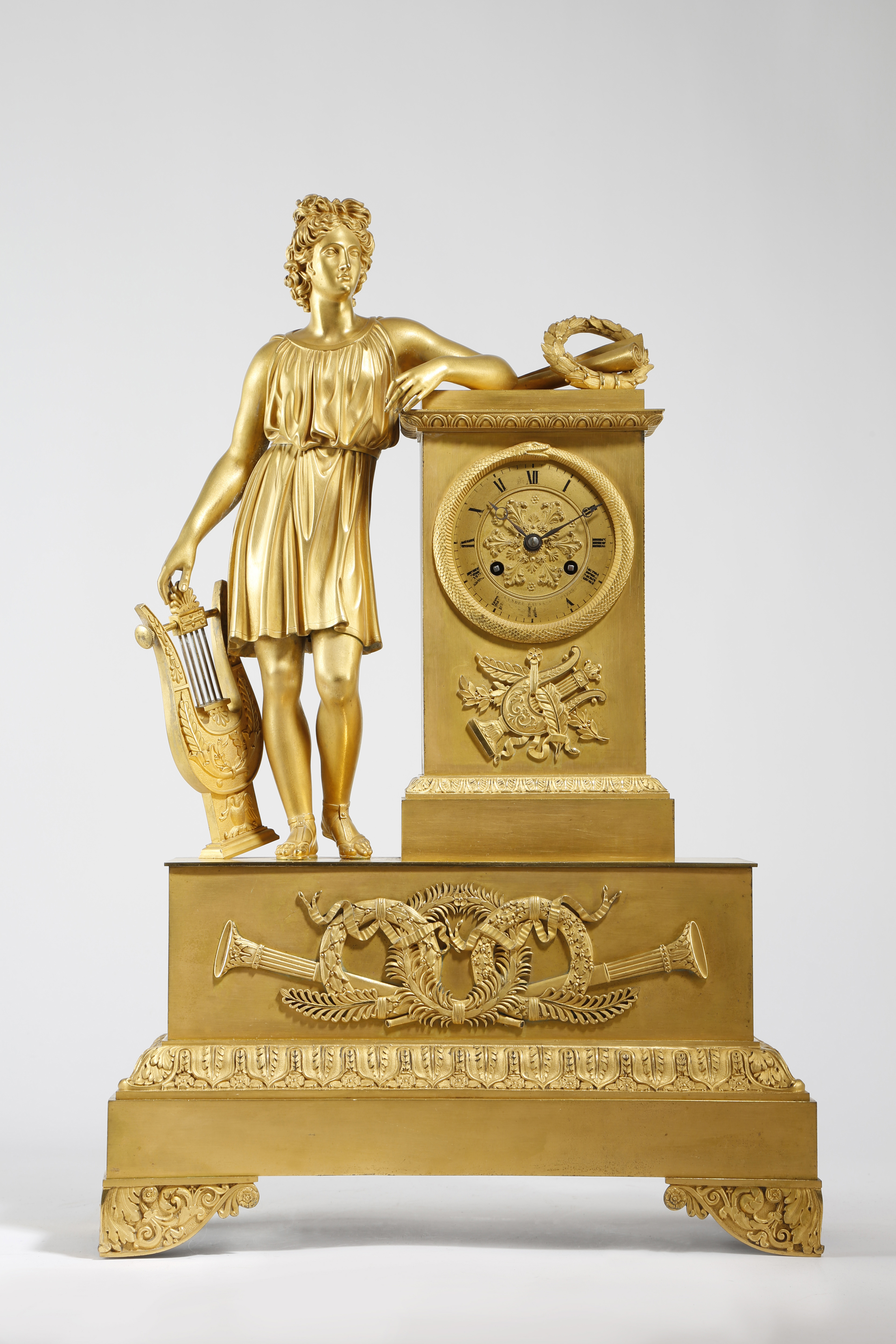A FRENCH EMPIRE ORMOLU FIGURAL MANTEL CLOCK BY ALEXANDRE ROUSSEL