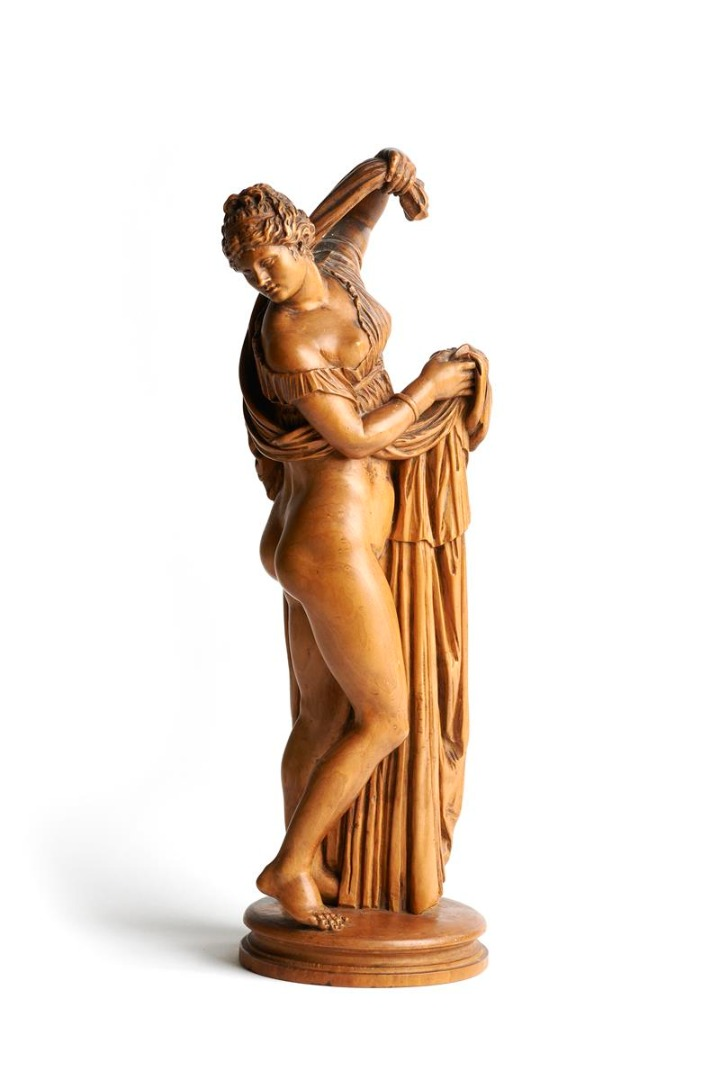 After the antique. An 18th century German boxwood figure of Venus Callipygos