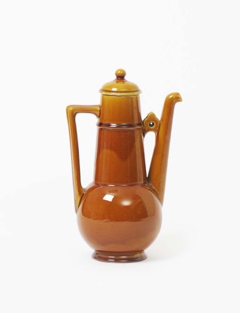 A Linthorpe Pottery coffee pot and cover designed by Dr Christopher Dresser