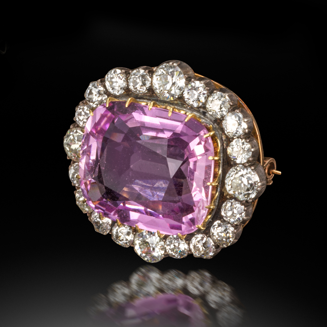 A Victorian pink topaz and diamond brooch