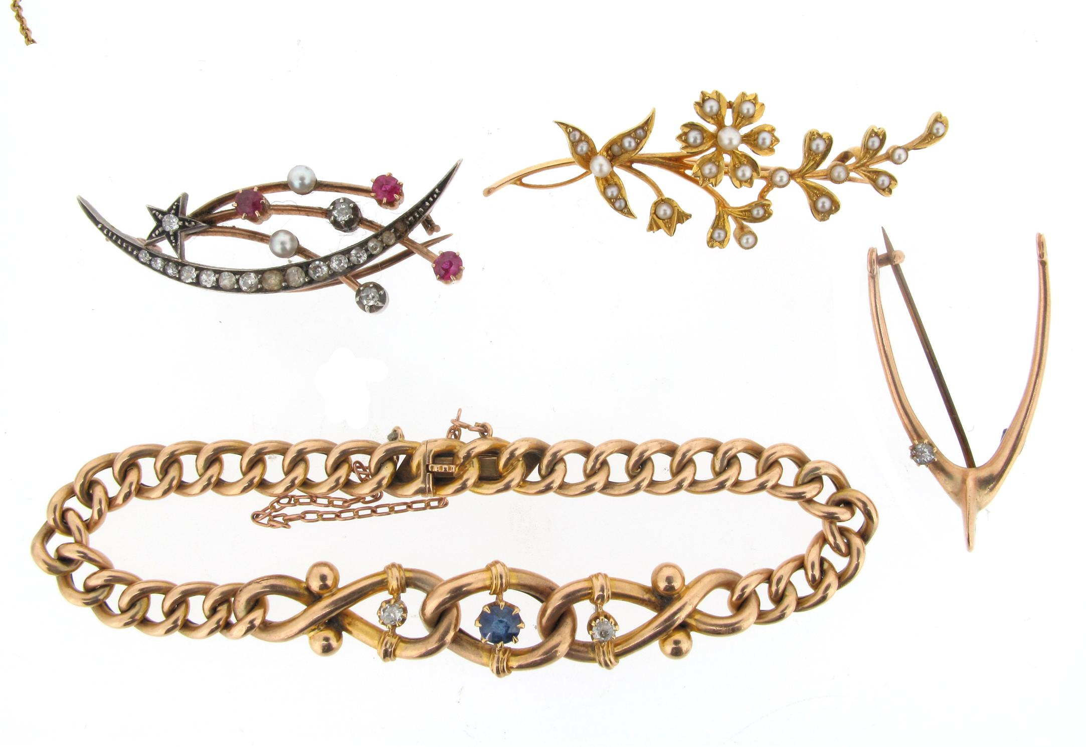 A 15ct gold curb link bracelet set with a sapphire and two diamonds and...