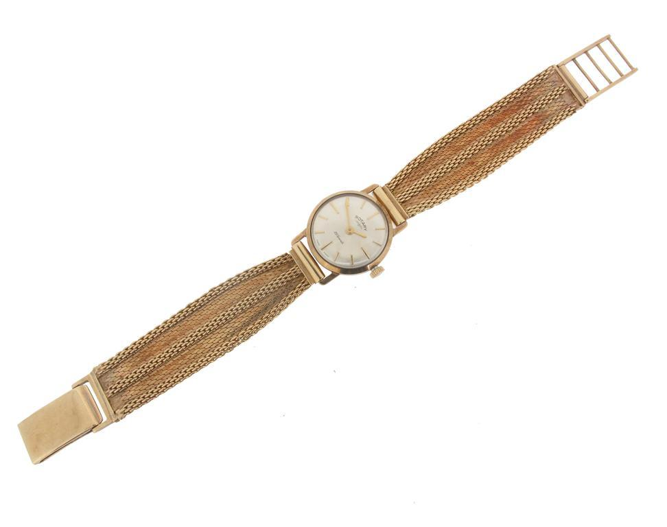 A lady's 9ct gold wristwatch by Rotary with 9ct integrated gold band...