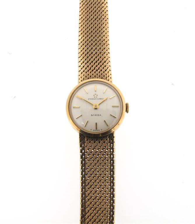 A ladies 9ct gold wristwatch. Eterna Matic Sahida. Integrated 9ct gold...