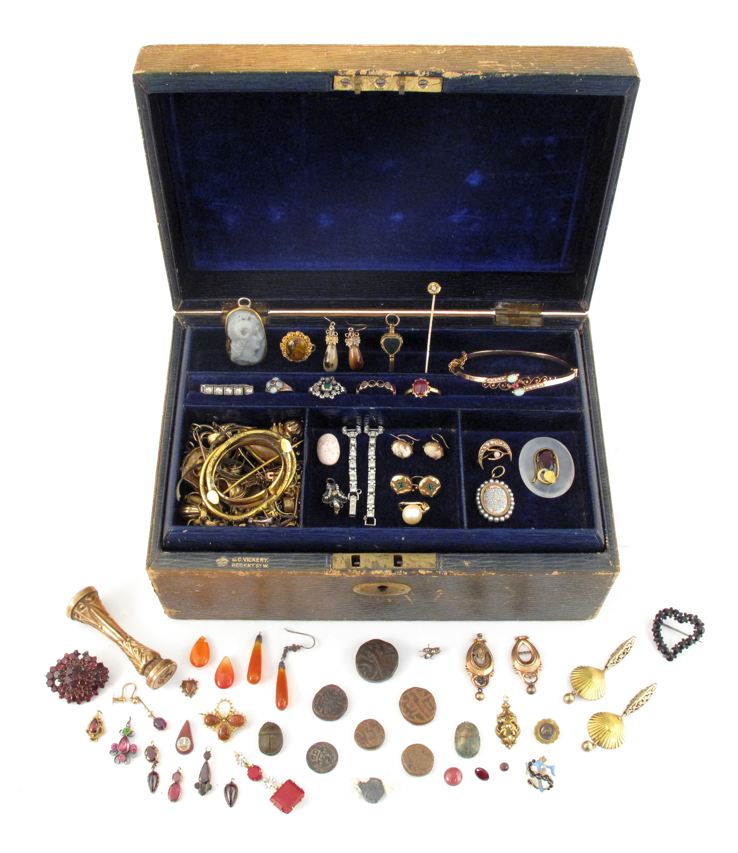A jewellery casket with lift-out draw containing various items of jewellery