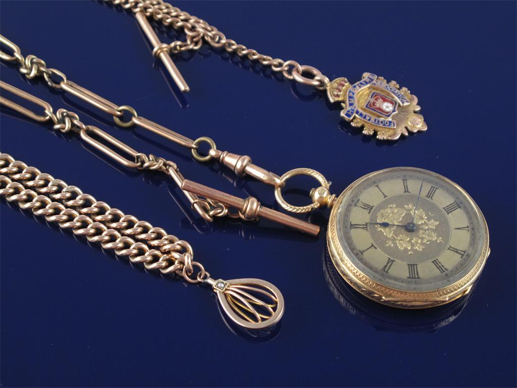 A 9ct gold curb link watch chain with gold pendant. 36g. A 9ct gold curb...