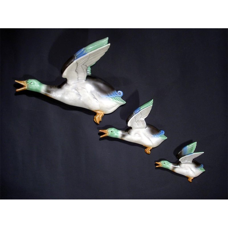 A set of three poole pottery graduated flying duck wall decorations ...