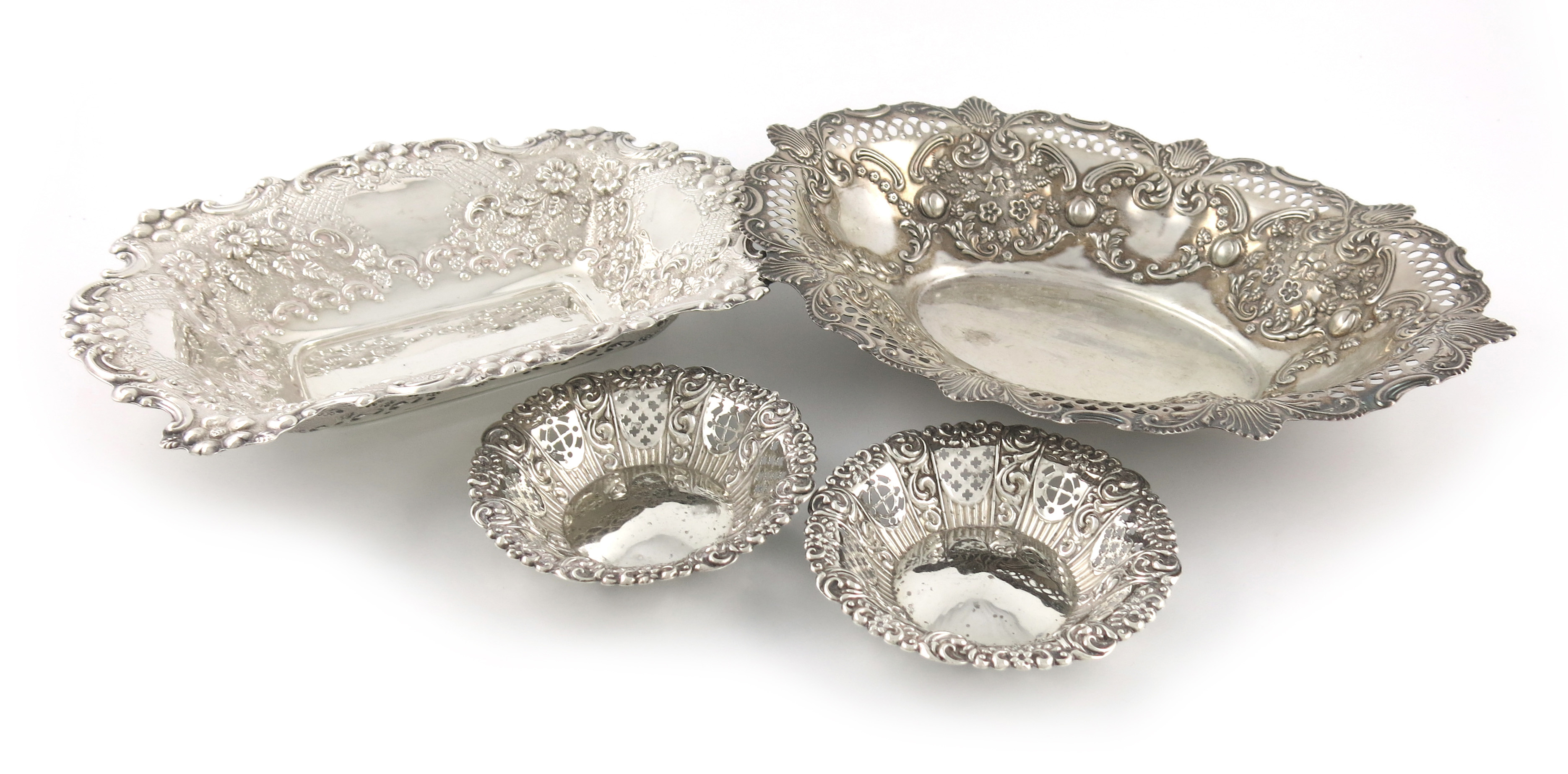 A small collection of four silver dishes
