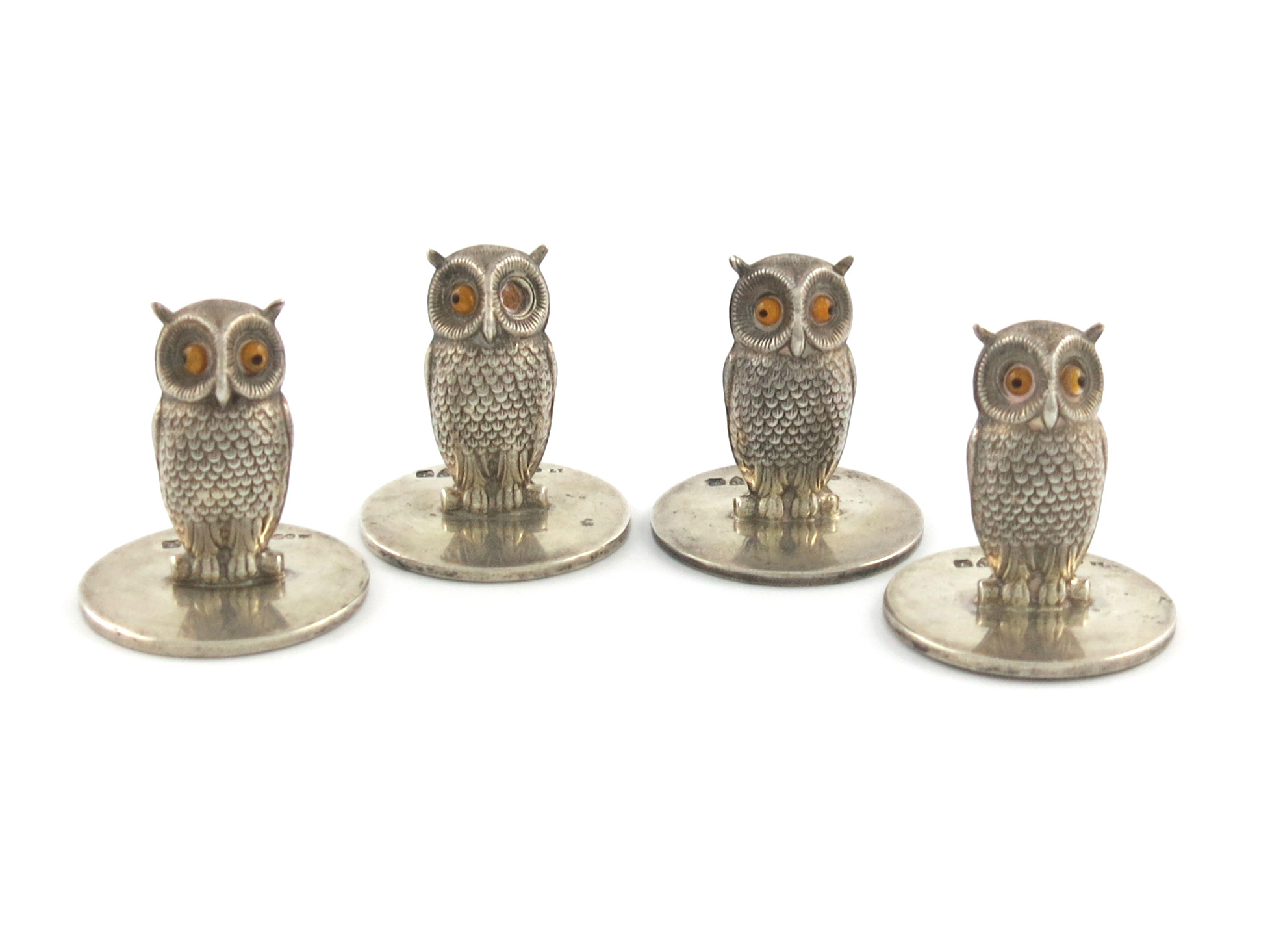 A set of four Edwardian novelty silver menu card holders