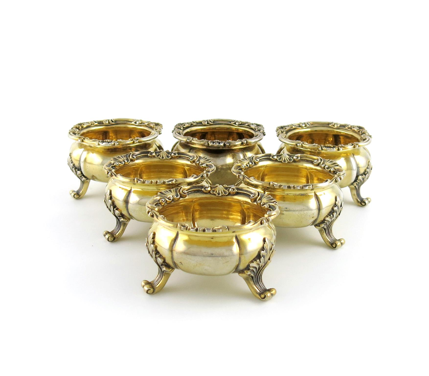 A matched set of six similar Victorian silver-gilt salt cellars