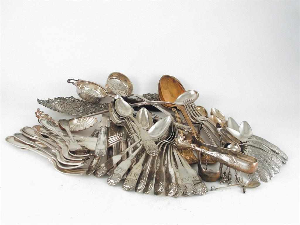 A miscellaneous lot of flatware and cutlery: a Russian enamelled teaspoon...